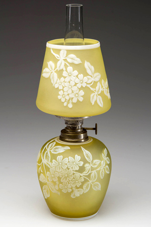 A rare English cameo floral and leaf pattern art glass miniature lamp sold for $11,500 at Jeffrey S. Evans' auction of Part II of Marjorie Hulsebus' miniature lighting collection. This was the top seller of the day. Jeffrey S. Evans & Associates image.