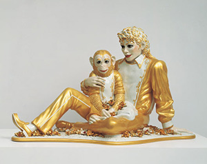 Jeff Koons' (American, b. 1955-) 'Banality' series culminated in 1988 with 'Michael Jackson and Bubbles,' a series of three life-size gold-leaf-planted porcelain statues of the singer cuddling his pet chimpanzee, Bubbles. One of the three is included in the Whitney Museum of American Art's 'Jeff Koons: A Retrospective,' which opens on June 27, 2014. Image courtesy of Whitney Museum of American Art.