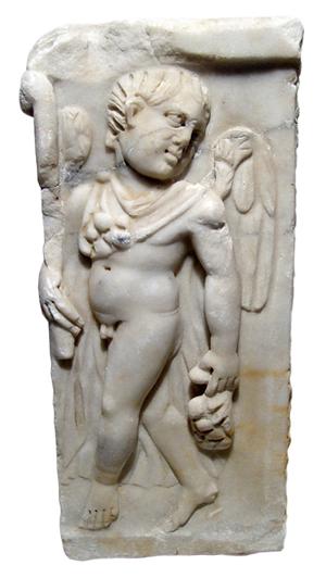 Provincial Roman marble frieze depicting nude Eros. Ancient Resource image.