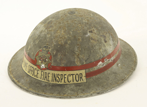 Scarce World War II tin fire helmet with NFS transfer, 'Home Office Fire Inspector,' complete with chin strap and liner, helmet marked ZA II HBH 1938. Estimate: £150-200. Sworders Fine Art Auctioneers.