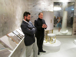 Viscount Linley (right) and his chief designer Michael Noah on the Linley stand at Masterpiece London. Image Auction Central News.