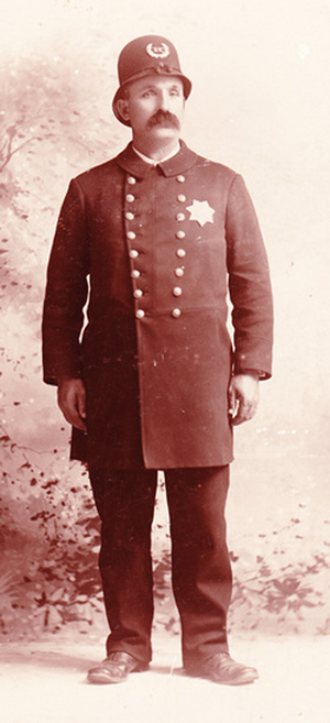 In this historical photo, Officer Griff Roberts wears a style of uniform that Portland police wore in the 1890s. Portland Police Museum image
