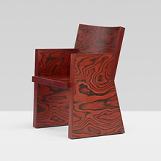 "The ""In Praise of Epicurus"" chair, a limited edition Sottsass design produced in 1987, is a desirable addition to any Memphis collection. This example - numbered ""18"" - brought $17,500 last year. Courtesy Wright Auctions"