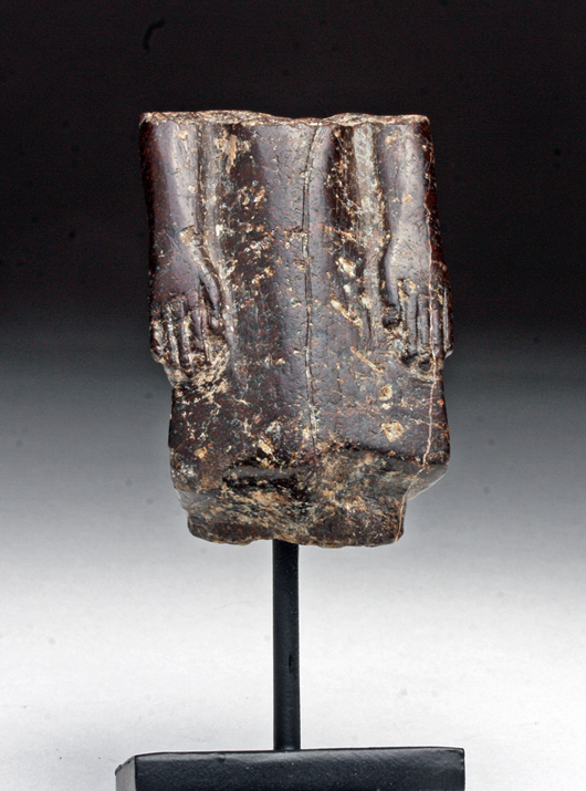 Egyptian granite striding king, circa 1550-1070 BCE. Est. $4,000-$6,000. Artemis Gallery image
