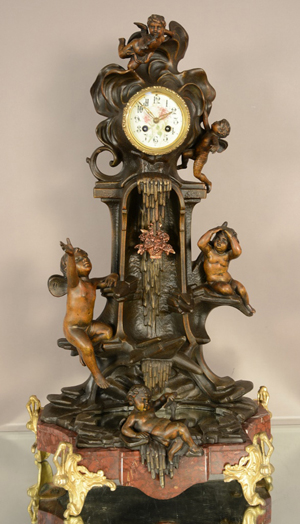 French Louis XV-style figural mantel clock, circa 1875. Bruhns Auction Gallery image.