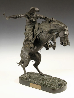 'Bronco Buster' bronze sculpture by Frederic S. Remington, signed and stamped by Roman Bronze Works and marked #75. Thomaston Place Auction Galleries image.