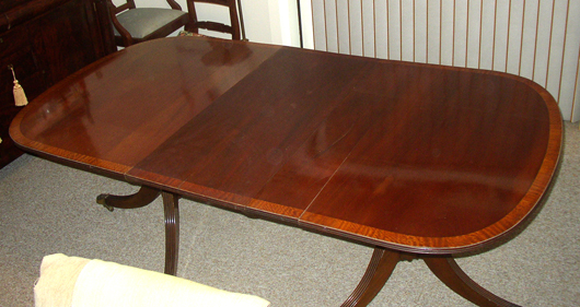 This late 18th century table is made of very wide single boards of solid mahogany with satinwood edge banding.