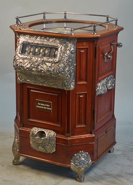 1904 Caille roulette floor machine, mahogany with ornate repousse, nickel-plated embellishments. Provenance: the William F. Harrah collection. Morphy Auctions/Victorian Casino Antiques image