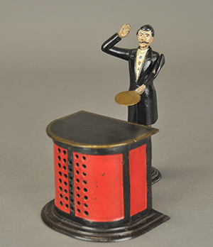 """One of the rarest pieces in the Max N. Berry collection is a circa-1876 """"Preacher at the Pulpit"""" mechanical bank made by the J. & E. Stevens Company of Cromwell, Connecticut. Coming to the auction marketplace with a long and distinguished line of provenance, it will be offered at auction with a $150,000-$175,000 estimate. Bertoia Auctions image."""