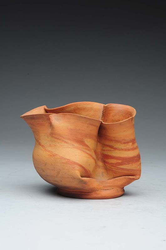George Ohr crimped bi-colored vessel, signed in script 'G.E. Ohr.' Est. $3,000-$5,000. Morphy Auctions image