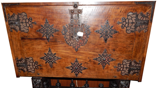 16th-century Spanish vargueno with drop-front door that creates writing surface. Joe R. Pyle Auction image
