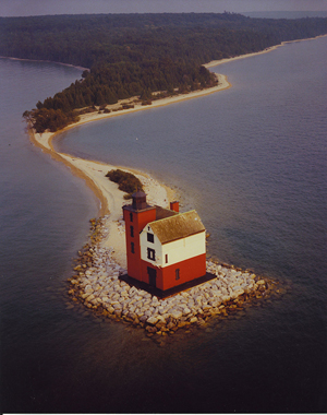 The Round Island Passage Light that is for sale should not be confused with the pictured Round Island Lighthouse on Round Island in the Mackinac Straits of Michigan. The 1895 Round Island Lighthouse was relit by a private foundation in 1996 and is now on the National Register of Historic Places. Image courtesy of Wikimedia Commons.