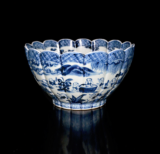 Lot 215, a blue and white 16-lobed large bowl painted with 22 children playing in a court garden scene, and the interior four children and Lingzhi and plantain. Ming Dynasty, Xuande six-character double-circled seal mark and of the period. Shi Yang Tang Collections, New York. Estimate: $400,000-$600,000. Gianguan Auctions image.