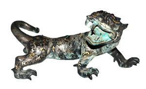 Lot 248, a gilt and silver-inlaid bronze and mythical beast cast with dragon head and tiger body inlaid with a pattern of cloud scrolls, geometric and beasts pattern and embellished with hardstone. Warring States period. Estimate: $80,000-$100,000. Gianguan Auctions image.