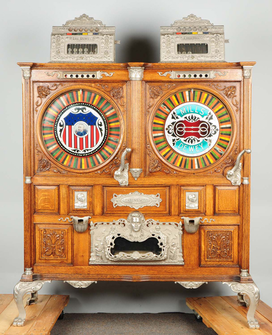 Mills Double Dewey upright slot machine, 5/25 cents, with original music, $114,000. Morphy Auctions image