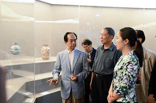Kwong Lum talking with guests at a museum preview. Kwong Lam Museum of Art image.