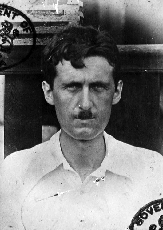 A passport photo showing George Orwell during his time in Burma in the 1920s, when her worked for the British government. Image courtesy of Wikimedia Commons.