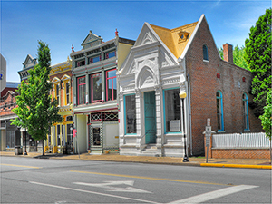 Facades in the downtown historic district of New Harmony, Ind. Image by Timothy K. Hamilton Creativity + Photography. This file is licensed under the Creative Commons Attribution 3.0 Unported license.