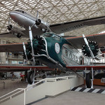 The Museum of Flight's 1929 Boeing Model 80A-1 (foreground), the only survivor of this model. It was recovered from a dump in Alaska in 1960. Image by Zendcee. This file is licensed under the Creative Commons Attribution-ShareAlike 3.0 Unported license.