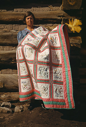 Russell Lee (American, 1903-1986) photograph of Mrs. Bill Stagg with states quilt, Pie Town, New Mexico. Russell photographed Japanese-American citizens sent to internment camps during World War II. Image courtesy of Wikimedia Commons.