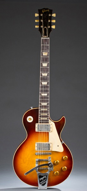 Rare 1960 Les Paul Sunburst electric guitar with Bigsby vibrato device and pick guard. Est. $20,000-$30,000. Quinn's Auction Gallery image.