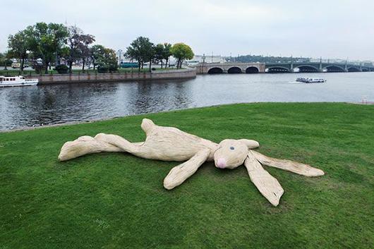 Smiling giant white rabbit in repose. Image courtesy of Studio Florentijn Hofman