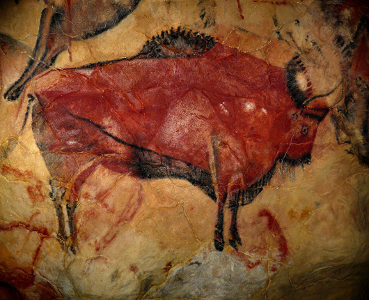 Upper Paleolithic polychrome painting of bison at the Cave of Altamira, located near Santillana del Mar, Spain. Photo by Rameessos. Licensed under public domain via Wikimedia Commons.