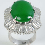Ladies ring with cabochon-cut jadeite center stone surrounded by 46 tapered baguette diamonds totaling 5.08 carats, $31,200. Morphy Auctions image