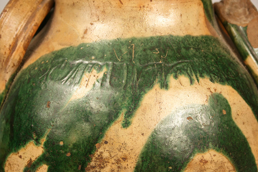 The stamped mark of C.A. Haun appears on the jar's shoulder underneath a splash of copper oxide glaze. Image courtesy Case Antiques.