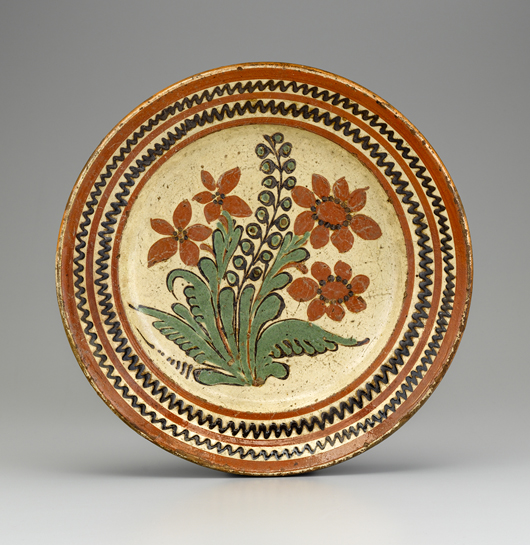 This decorated lead-glazed earthenware dish attributed to Gottfried Aust of Salem, N.C., circa 1775-1785, will be another exhibit in the new Mariner Gallery at MESDA. Image courtesy Old Salem Museums and Gardens.