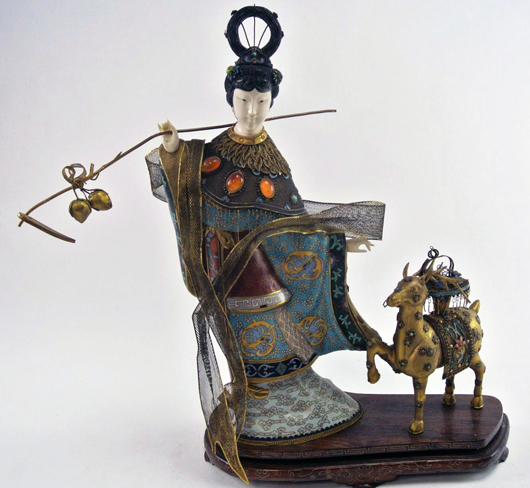Within the extensive selection of Asian decorative art is a jeweled and enameled cloisonné Quan Yin figure with a deer. Est. $1,800-$2,500. Don Presley image