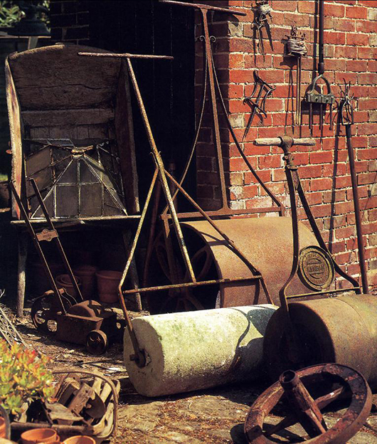 Ready for garden action: a selection of rollers and hanging on the wall, a group of garden lines. A handlight sits in the wooden wheelbarrow on the left. Photo: Alistair Morris.