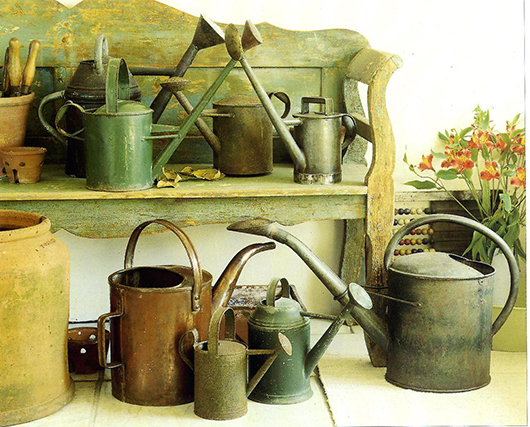 A selection of French and English watering cans including one small enough to be child-firendly, circa 1920. Photo Alastair Morris.