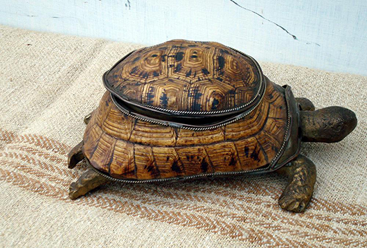 A tortoise lidded box – only the shell is real. The rest of the animal is cast brass. Photo Garden Artefacts.