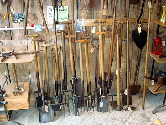 Some of the spades, forks and hoes in Graham's collection. Photo Garden Artefacts.