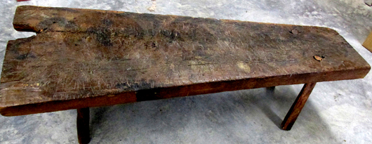 19th century Smoky Mountains table handcrafted from a slab of wood formerly used for meat cutting and curing. Estate of Carolyn McCarter and the late Roy McCarter. John W. Coker image