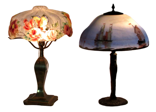 Left: Marked Pairpoint 1907 lamp with butterfly and floral motif. Right: Scenic art-glass lamp depicting junks on the water, possibly by Handel. From the Estate of Elizabeth and Donald Bates. John W. Coker image