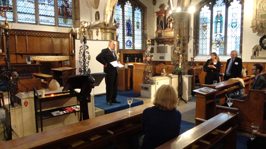 Sir Norman Palmer, CBE, addresses the faithful at the relaunch of Art Resolve at St. Olave's Church in the City of London in September. Image Auction Central News.