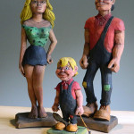 Wood-carver Harold Enlow's depiction of Dogpatch characters Daisy Mae Yokum, Li'l Abner Yokum and their son Honest Abe Yokum. Image courtesy of Don Arnett and the Boone County (Ark.) Heritage Museum.
