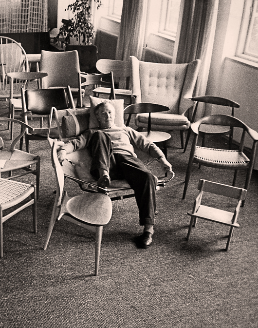 Hans J. Wegner lounges with some of his most memorable chairs. Photo courtesy Design Museum Denmark.
