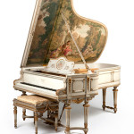 As much a work of art as a functioning instrument, this Louis XVI-style Steinway Model B piano, serial number 99,999, was painted with a 'fete galante' by Arthur Thomas in 1907. Estimated at $30,000–40,000, it sold for $39,975. John Moran Auctioneers image.