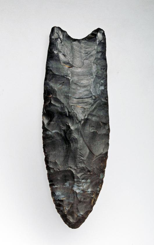 Prehistoric Paleo-Indian Clovis point, circa 16000-8600 BC.  Est. $9,000-$12,000. Artemis Gallery image