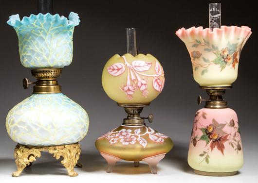 Sample of rare art glass miniature lamps including Cameo, Burmese and satin glass. Jeffrey S. Evans & Associates image.