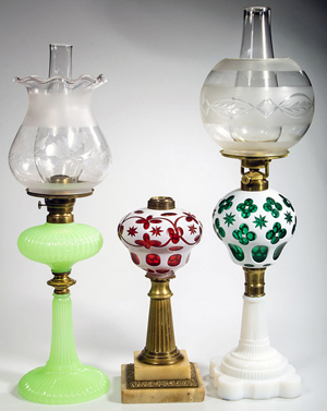 Many outstanding early kerosene period lamps including a fine Sandwich Onion and a good selection of Sandwich and other cut overlays. Jeffrey S. Evans & Associates image.