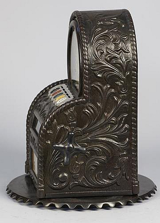 Caille 5-cent 'Busy Bee' cast-iron countertop 5-way-wheel trade stimulator, $44,400. Morphy Auctions image