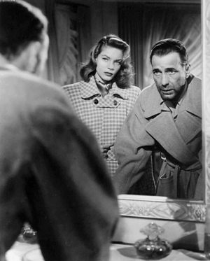 Lauren Bacall and Humphrey Bogart in a scene from the 1947 film 'Dark Passage.' Image courtesy of Wikimedia Commons.