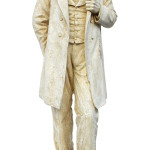 Cast composition statue of 'Standing Lincoln' after Augustus Saint-Gaudens's bronze unveiled in 1881 at Chicago's Lincoln Park. This sculpture stands nearly 7 1/2 feet high. Roland Auctions image.