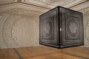 Anila Quayyum Agha of Indianapolis won the Juried Grand Prize and the Public Vote at ArtPrize for 'Intersections,' a 6-foot carved cube that casts intricate shadows throughout a room. Image courtesy of ArtPrize.