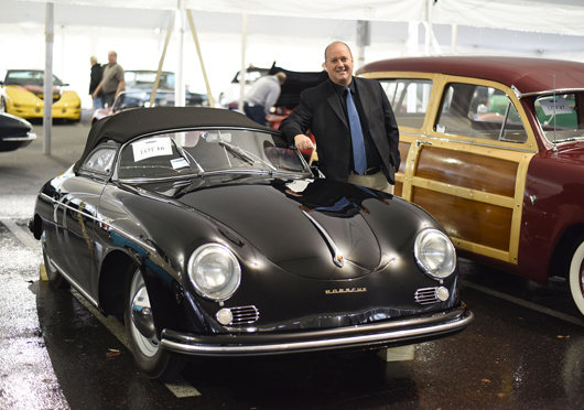 Dan Morphy, president of Morphy Auctions, with the top-finishing lot of the Oct. 11, 2014 Automobile Auction. The 1955 Porsche Speedster sold for $198,000. Morphy Auctions image