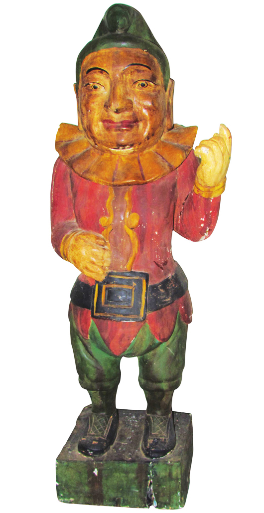 Nineteenth century Punch cigar store wood figure, 69 1/2 inches tall and with a contemporary base. Price realized: $102,600. Showtime Auction Services image